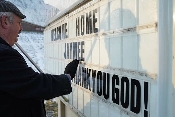 Floyd Lunde changes the sign outside of First Baptist Church.