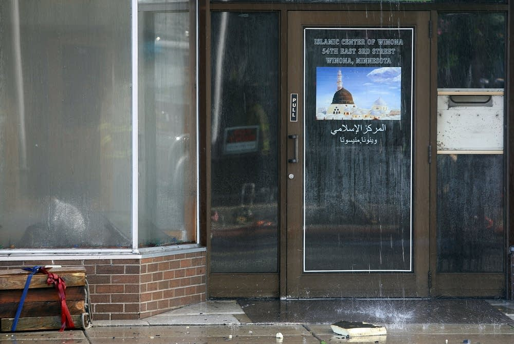 Water pours down the front of the Islamic Center.