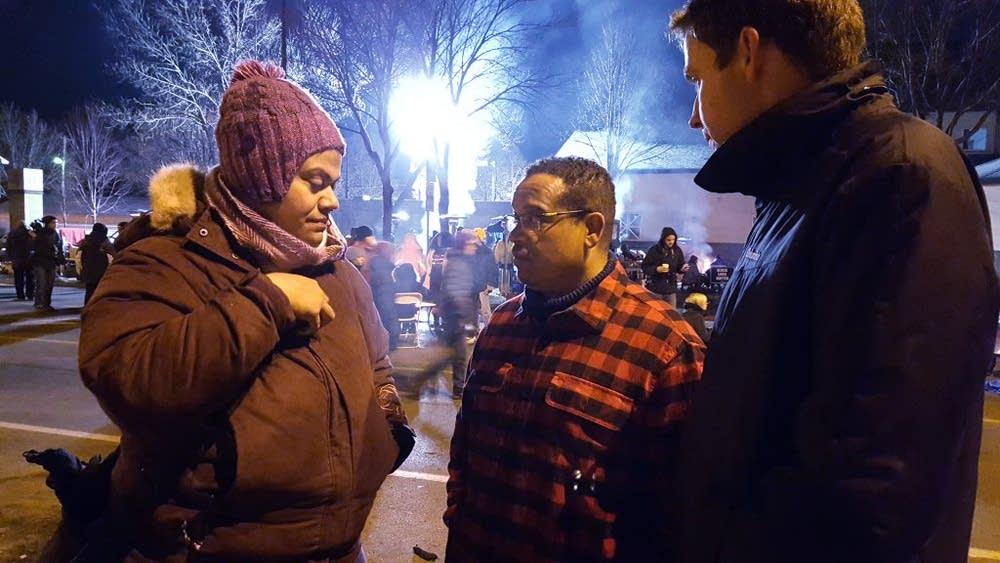 Rep. Keith Ellison talks to demonstrators