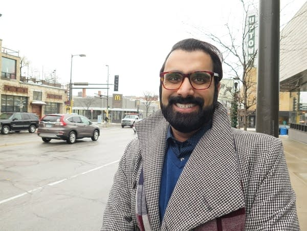 Rushabh Bhakta poses for a portrait outside Walker Library in Minneapolis