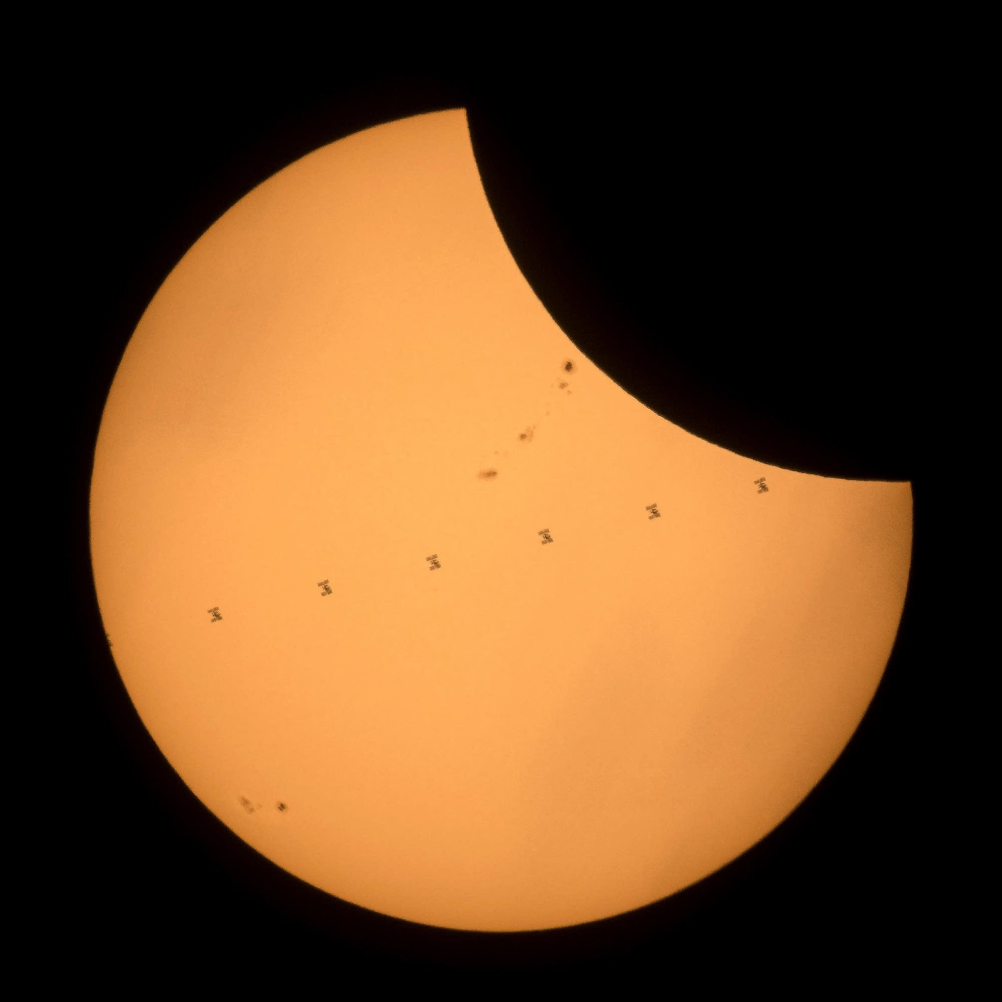 The International Space Station as it crosses the sun.