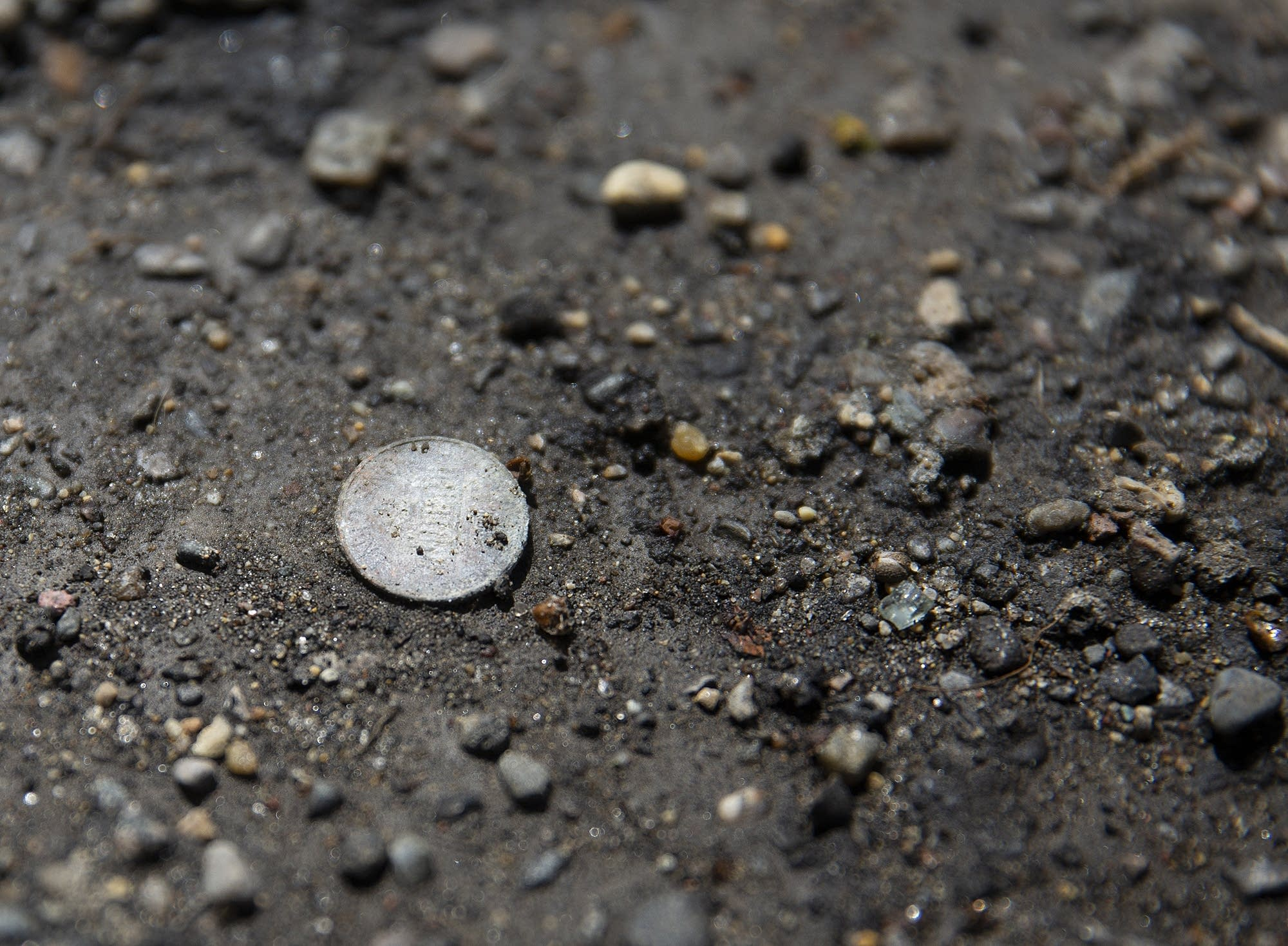 A penny sits on the ground at a trailer where a girl choked to death.