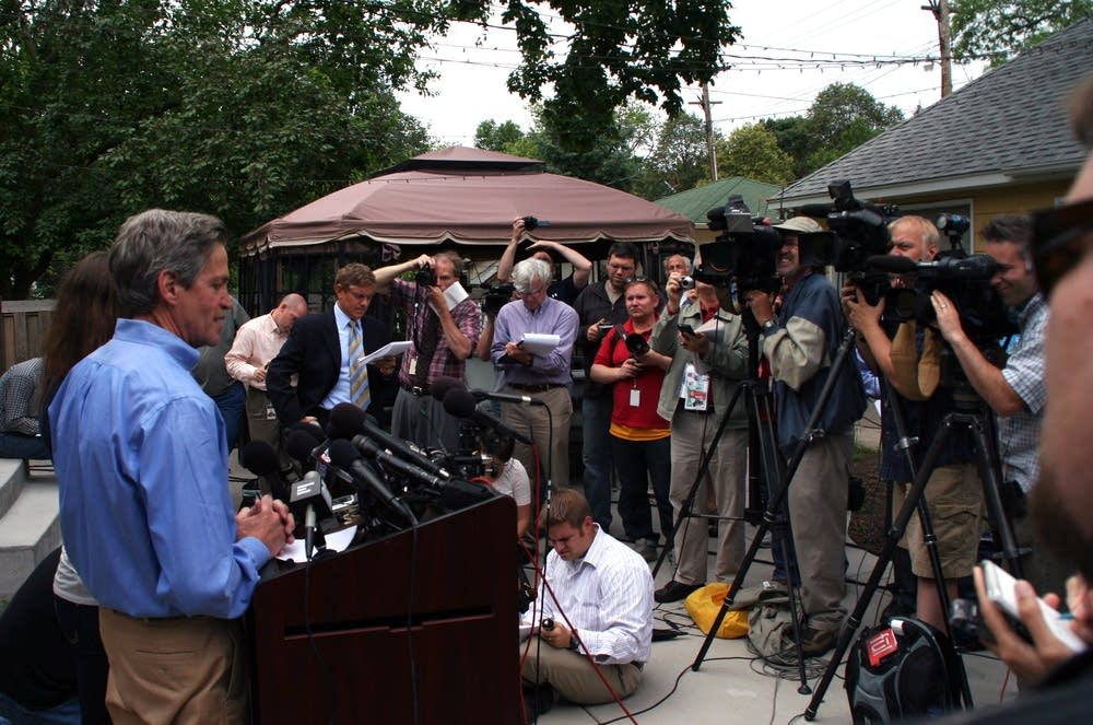 Norm Coleman addresses media at his home