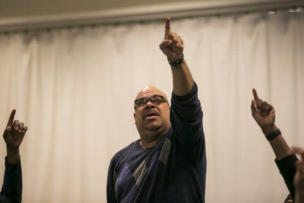 Actor T. Mychael Rambo points into the air while rehearsing