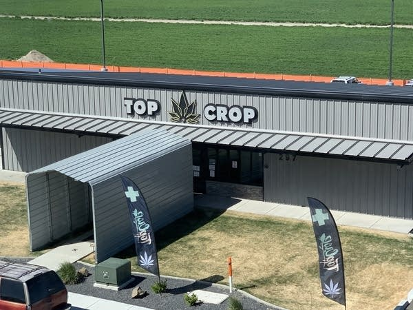 """Photo of weed store exterior called """"Top Crop"""""""