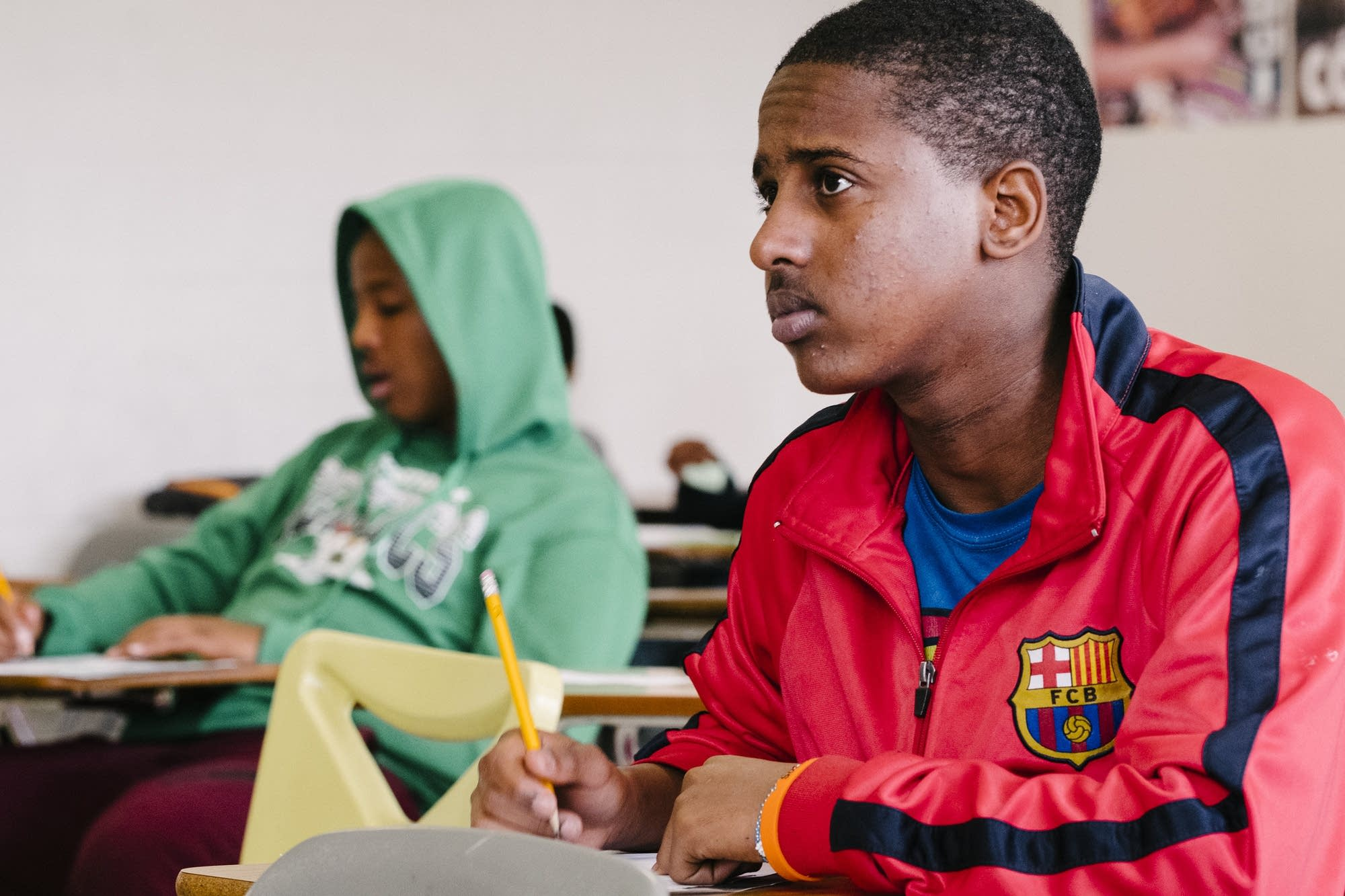 Two students listen in their Somali language class.