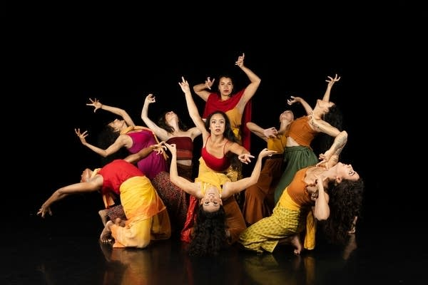 Dancers pose for a photo.