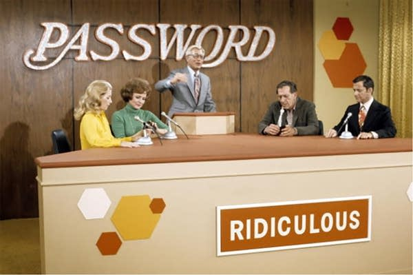 """Still shot from """"Password"""" game show, 1960s. 4 contestants + host."""