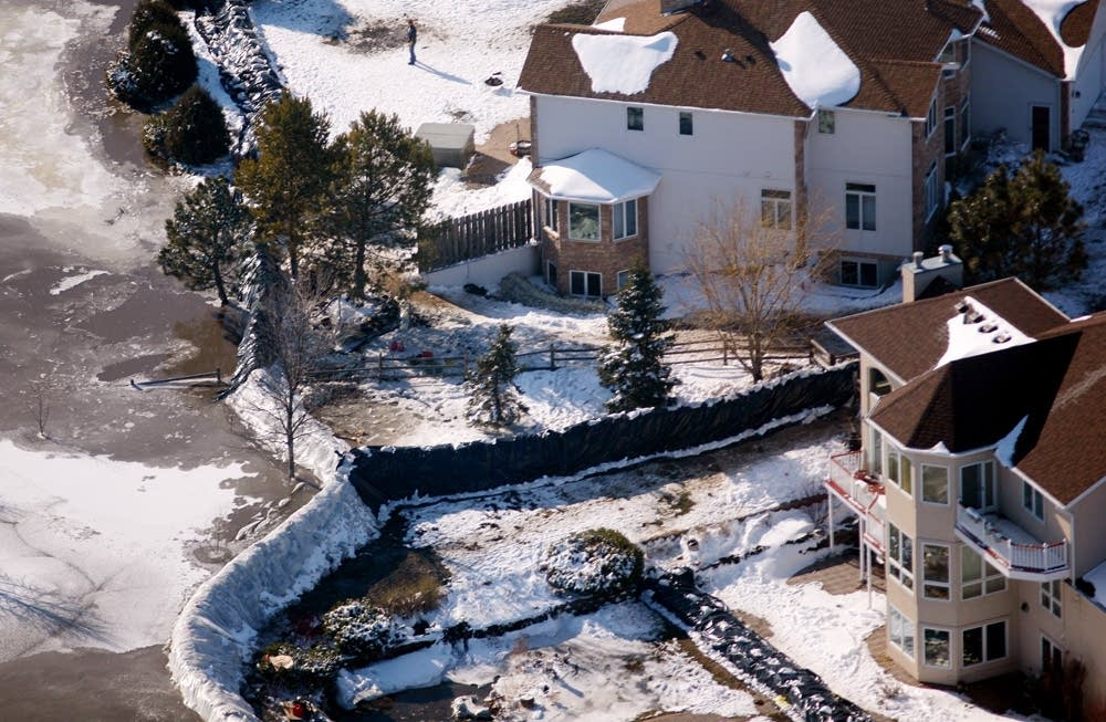 Dikes hold back the water in a Fargo neighborhood