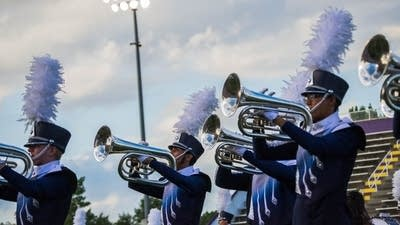 Hear the horns of River City Rhythm drum and bugle corps