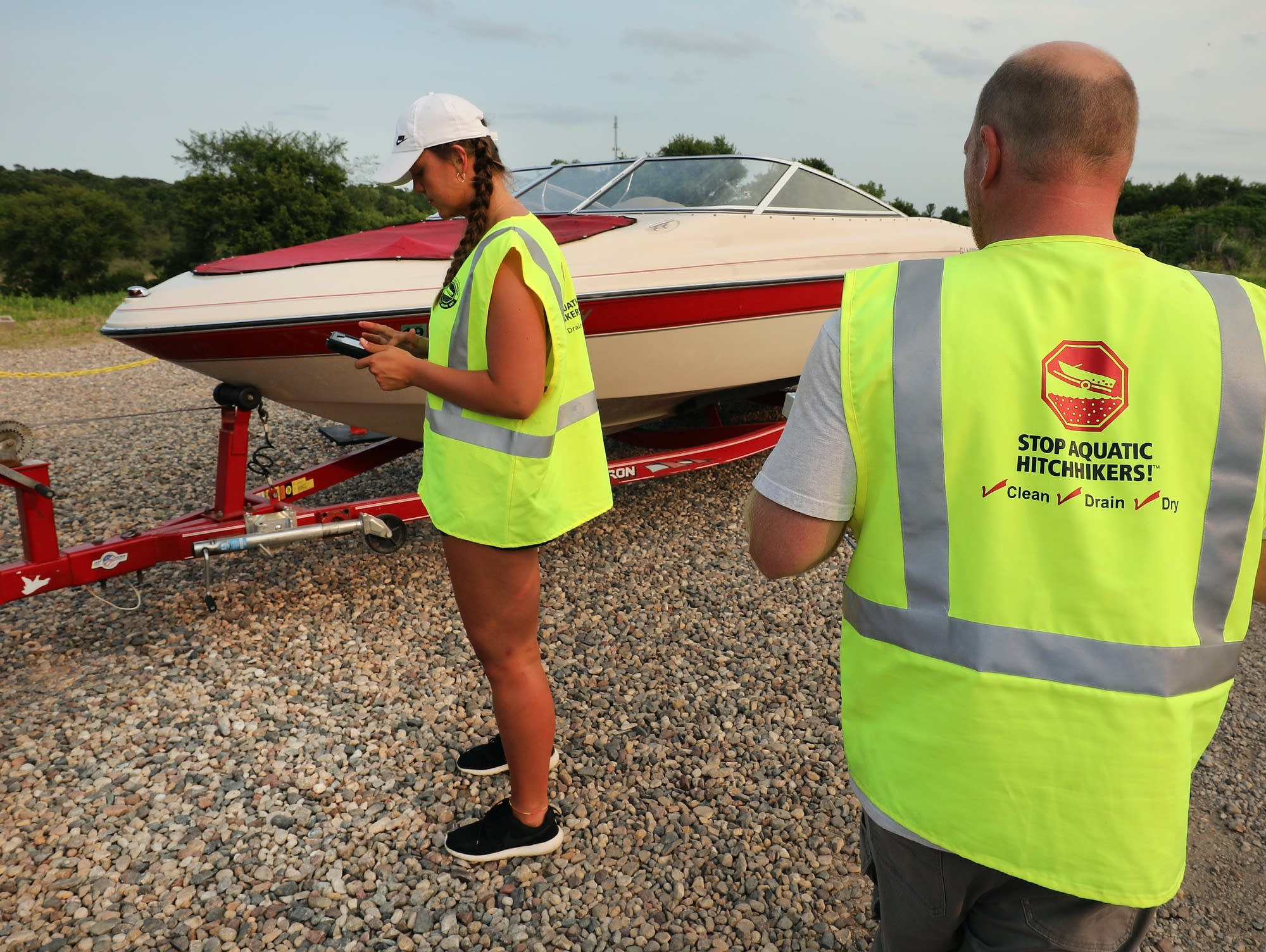 Bradley Hansen (right) and Hannah Purcell inspect a boat.