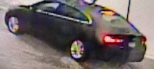 A low resolution image of a black car.