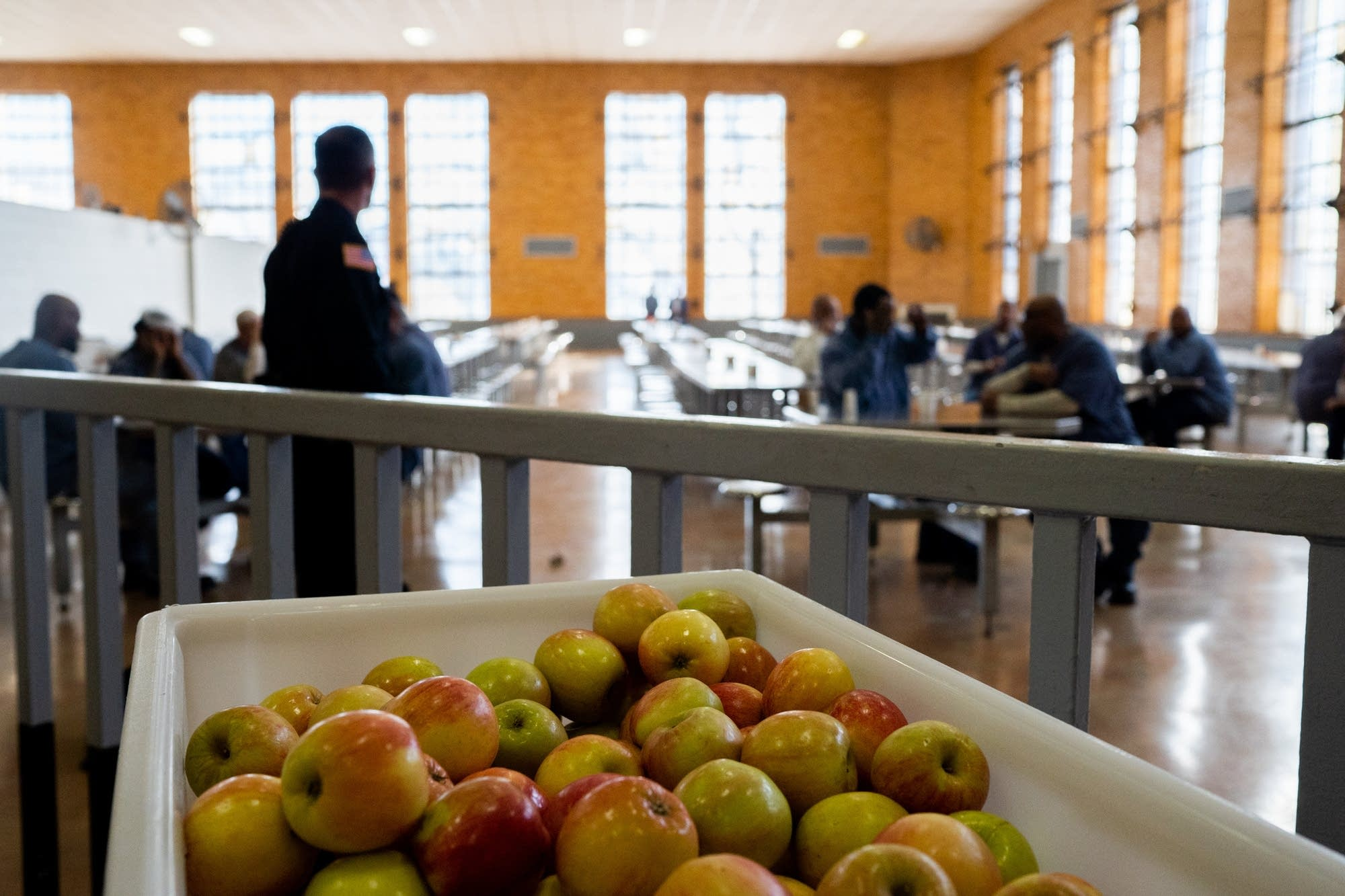 A cart of apples sits out in the dining hall of Stillwater prison.