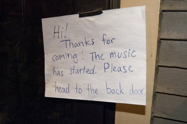 A sign hangs on the front door of the concert.