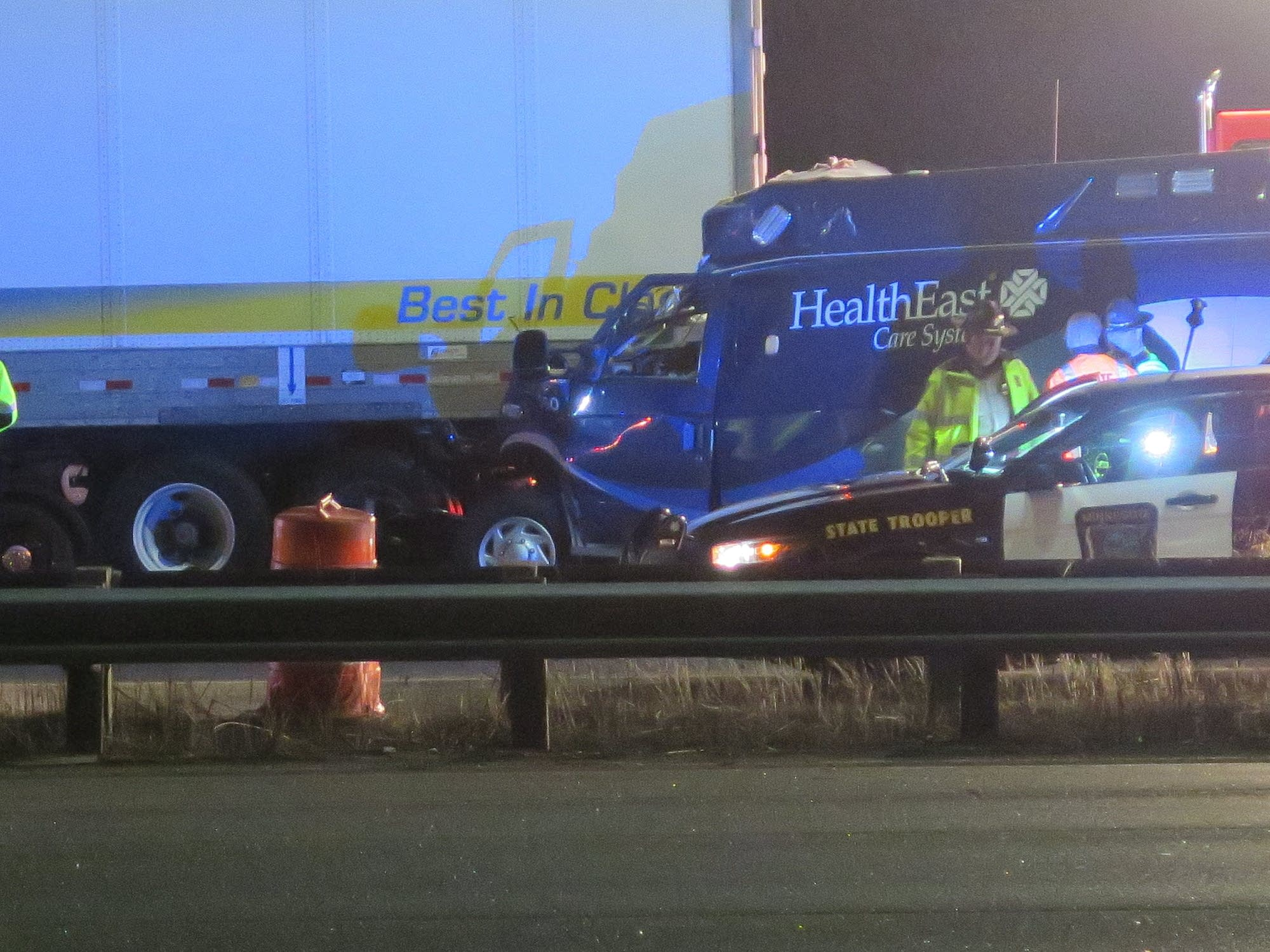 Paramedic killed after ambulance crashes into semi.