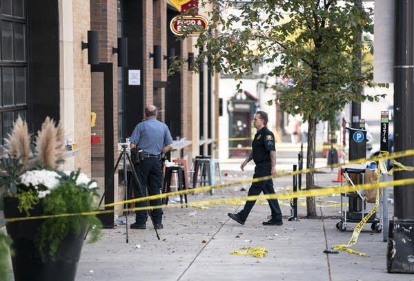 Police behind crime scene tape.
