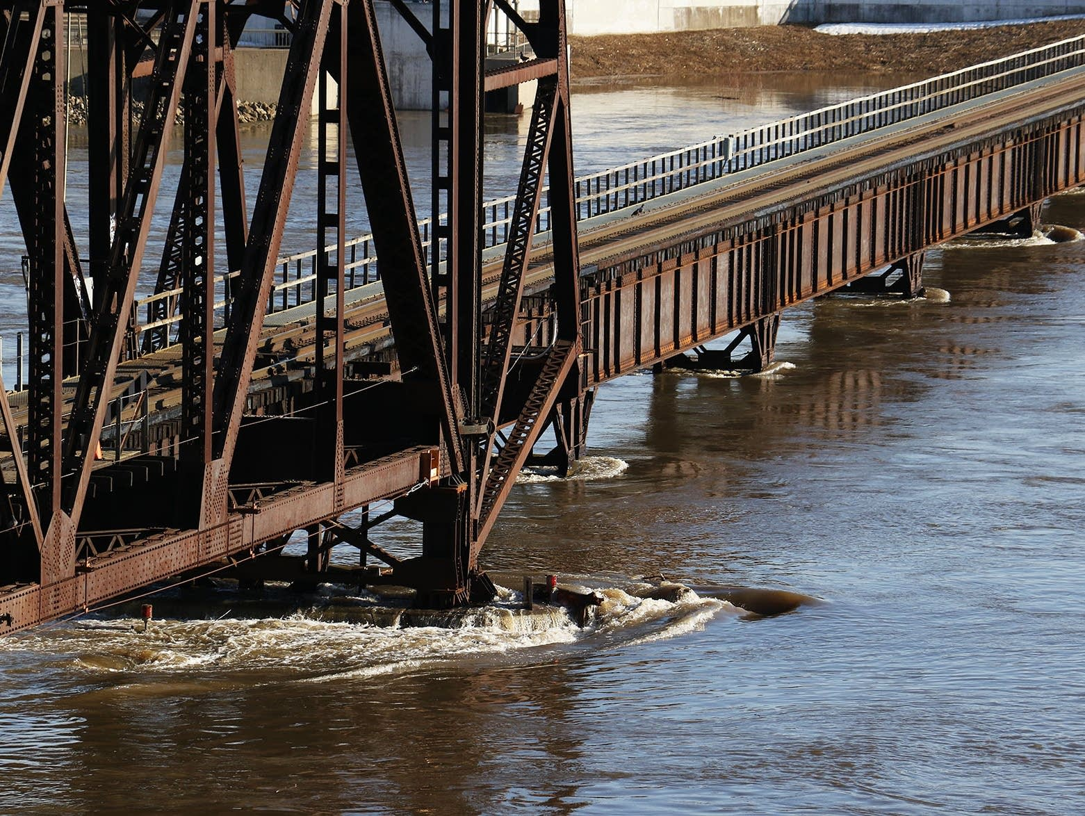 The strong current of the Mississippi River in flood stage