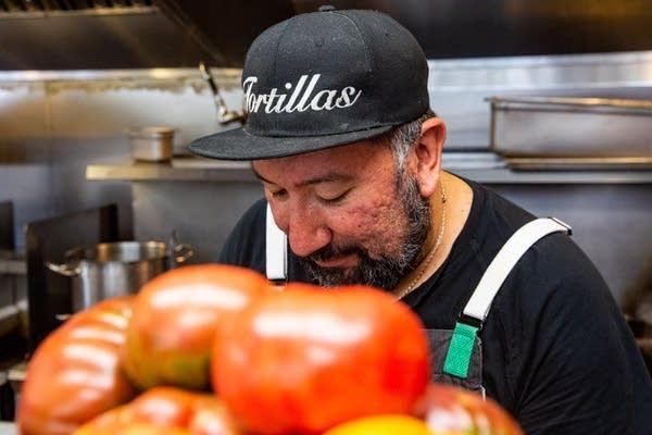 A man wears a hat that says Tortillas.