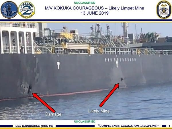 Damage and a suspected mine on the Kokuka Courageous in the Gulf of Oman.