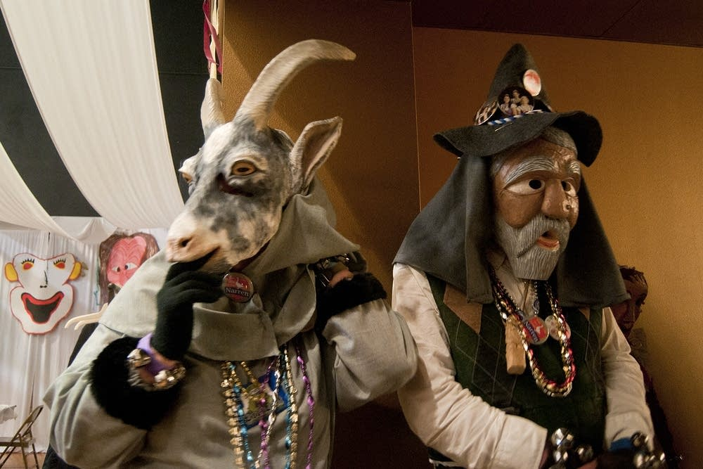 Sue Hogan, left, adjusts her goat mask