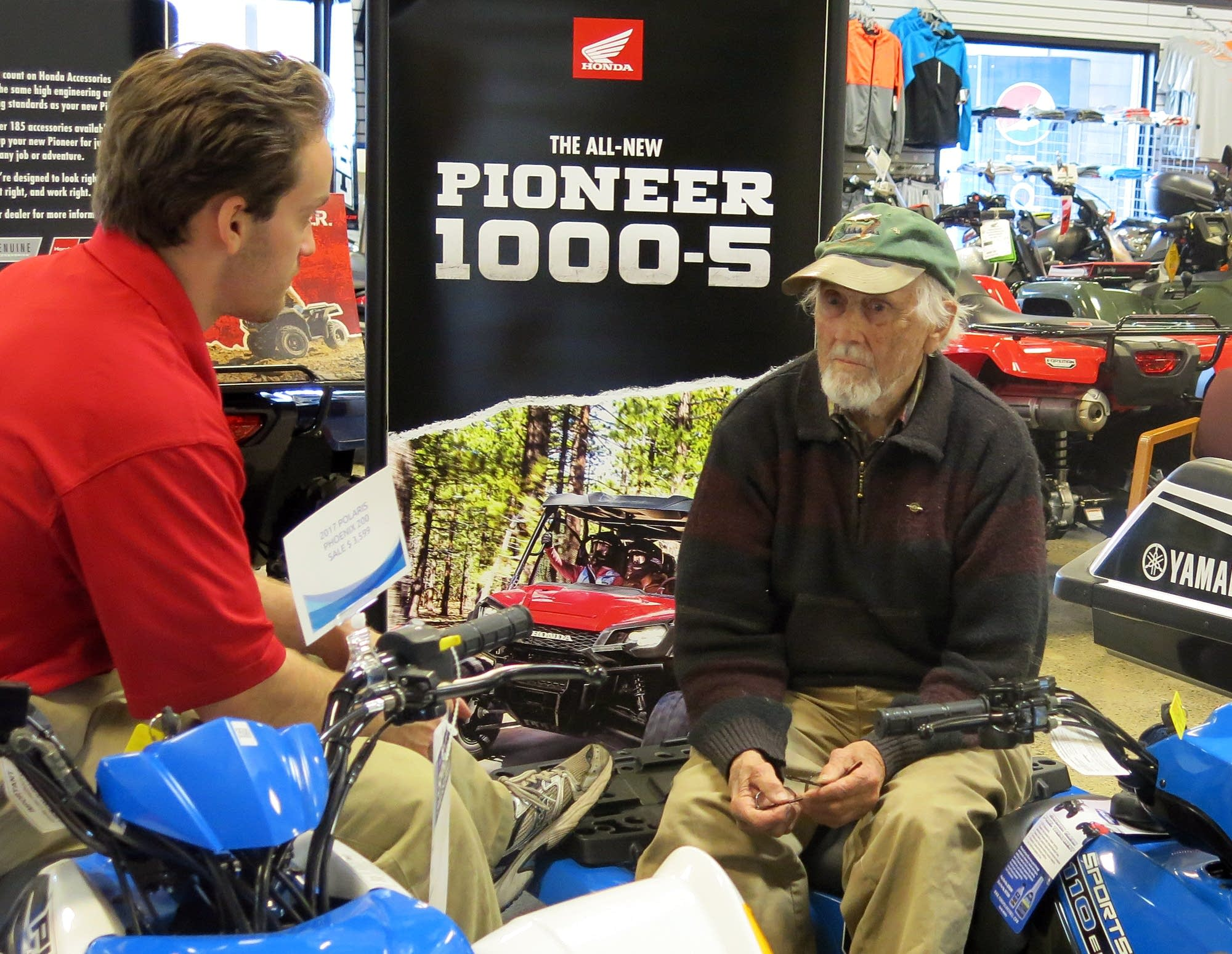 Carl Seemann talks with salesman John Frank at Bemidji Sports Center.