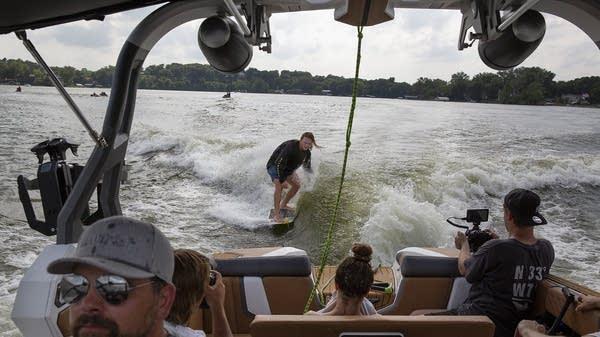 Professional wakesurfer Noah Flegel surfs behind a wakeboat on Lake Minnetonka.