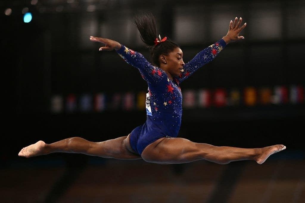 A woman leaps.