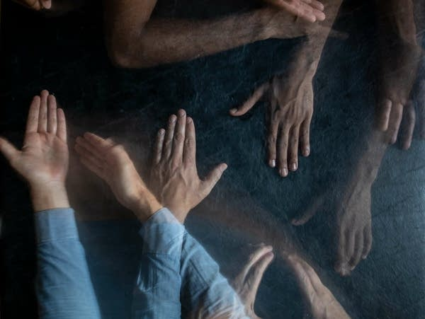 A photo illustration of hands that appear translucent.
