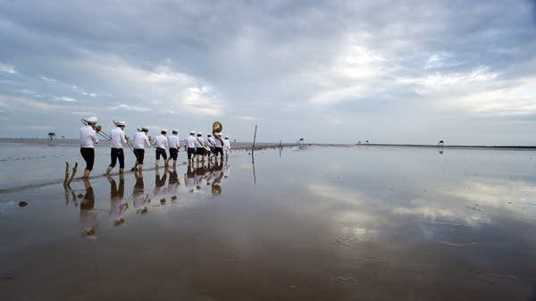 The film includes a Vietnamese brass band which performs at funerals.