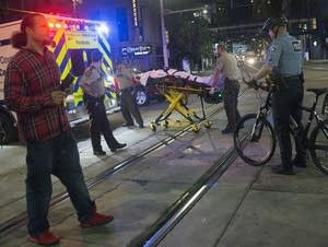 An injured pedestrian is loaded into an ambulance on Hennepin Avenue.