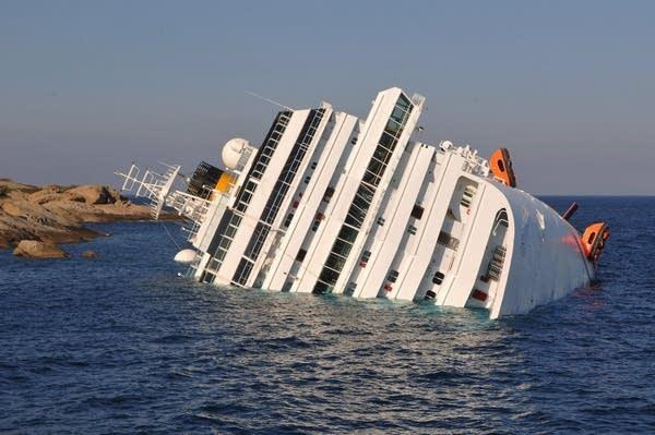 Italian divers find body in cruise ship corridor | MPR News