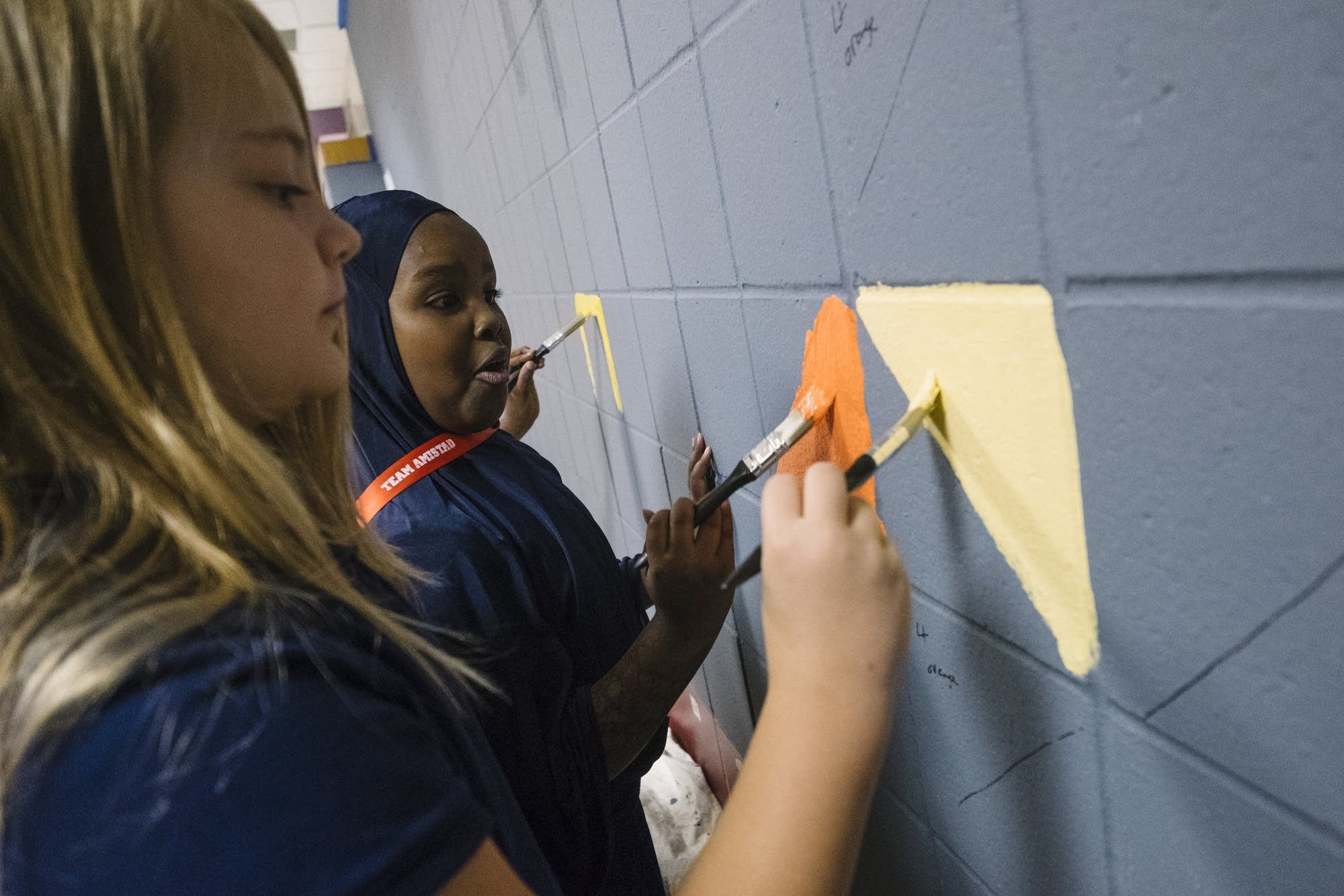 Jenny Lind students paint the mural together.