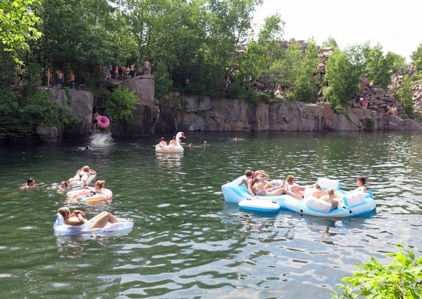 Visitors swim at the Quarry Park and Nature Preserve in Waite Park.