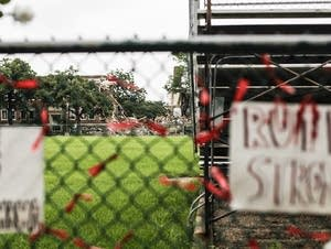 A memorial rests on the fence that blocks the rumble of Minnehaha Academy.