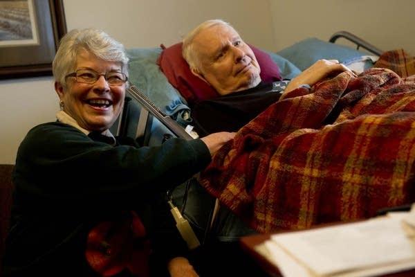 Elaine and Hank Scherdin listen to the harp