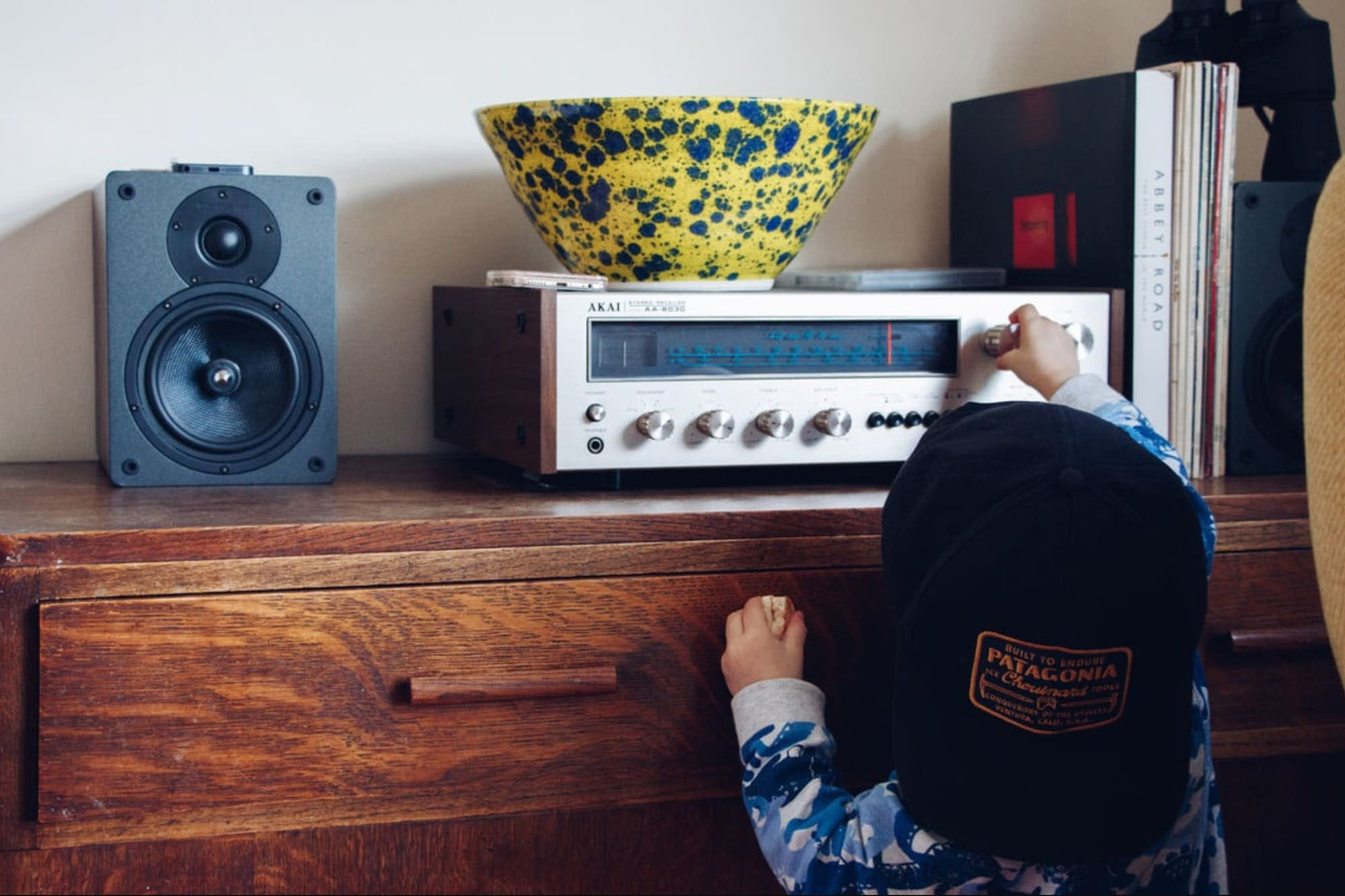 A child tunes a radio