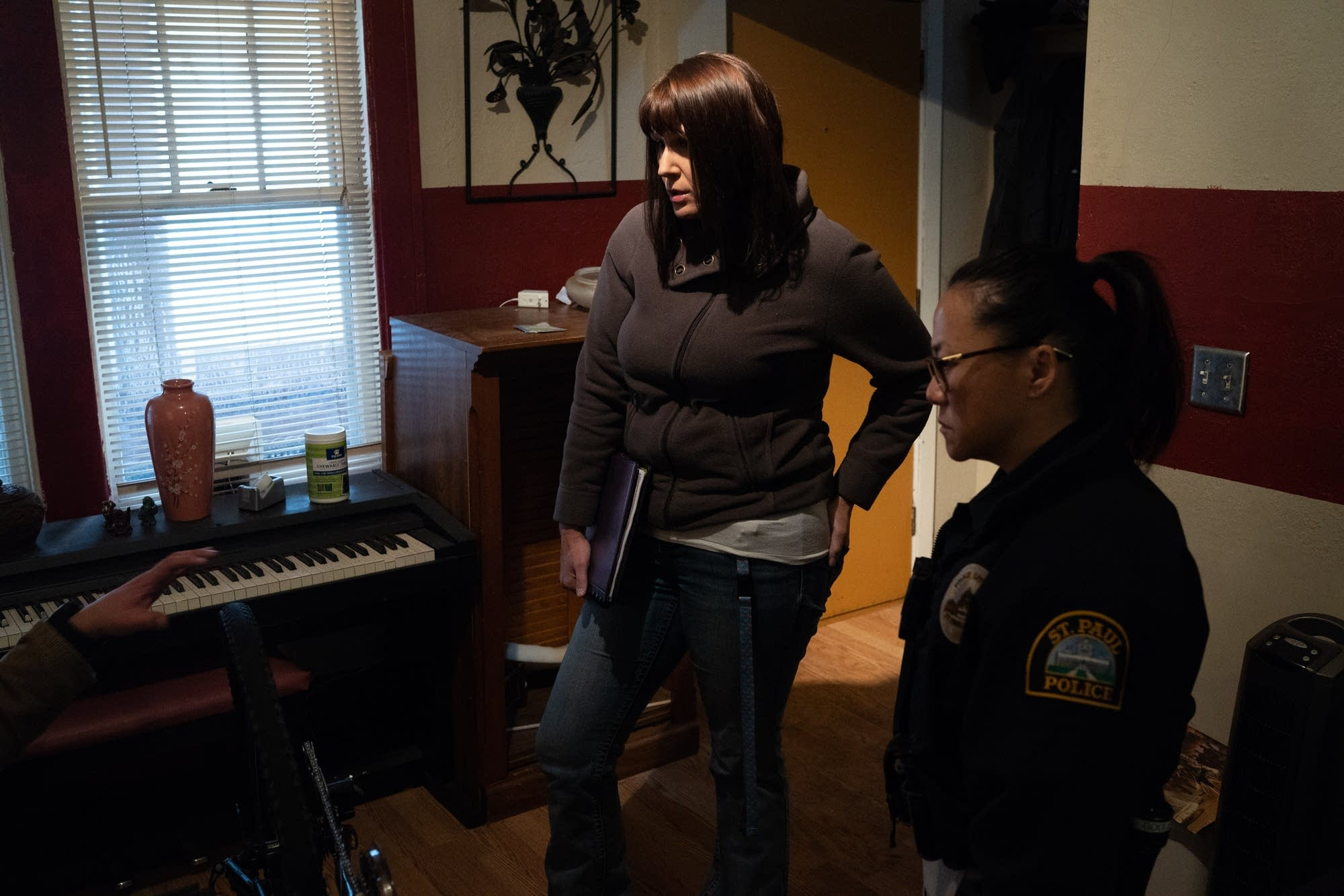 Social worker Amber Ruth and officer Lori Goulet consult a person.