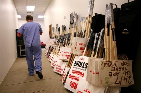 Strike signs wait in MNA hallways