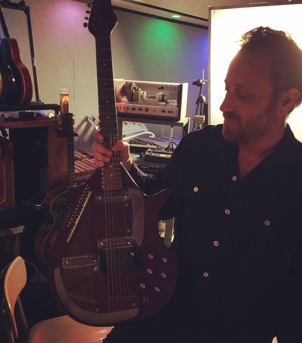 Dan Auerbach holds the sitar guitar