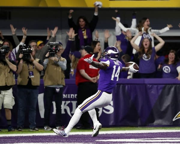 Vikings wide receiver Stefon Diggs (14) celebrates in the end zone.