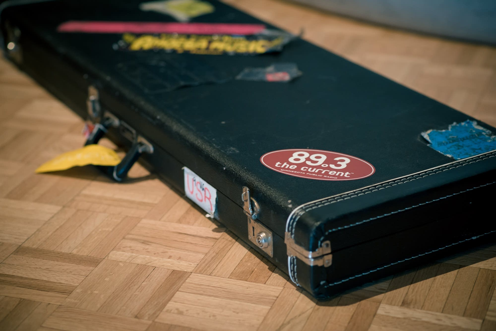 Bass case with a Current sticker