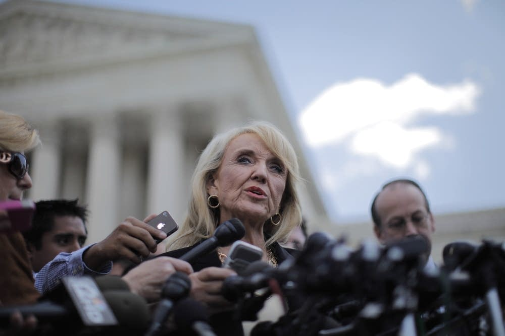 Jan Brewer outside the Supreme Court