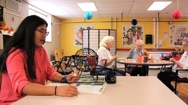 Ashley McGaw runs the bingo game at Senior Living at Watkins.