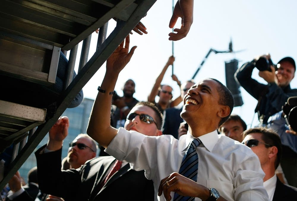 Obama greets supporters at a rally in Iowa