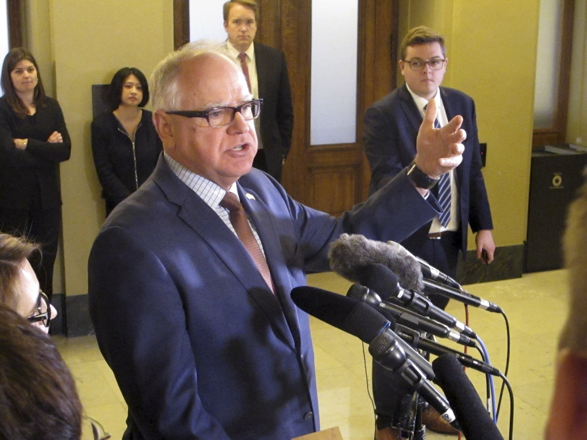 Minnesota Gov. Tim Walz speaks with reporters at the state Capitol.