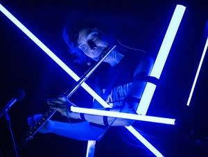Claire Chase plays with LED lights attached to her.