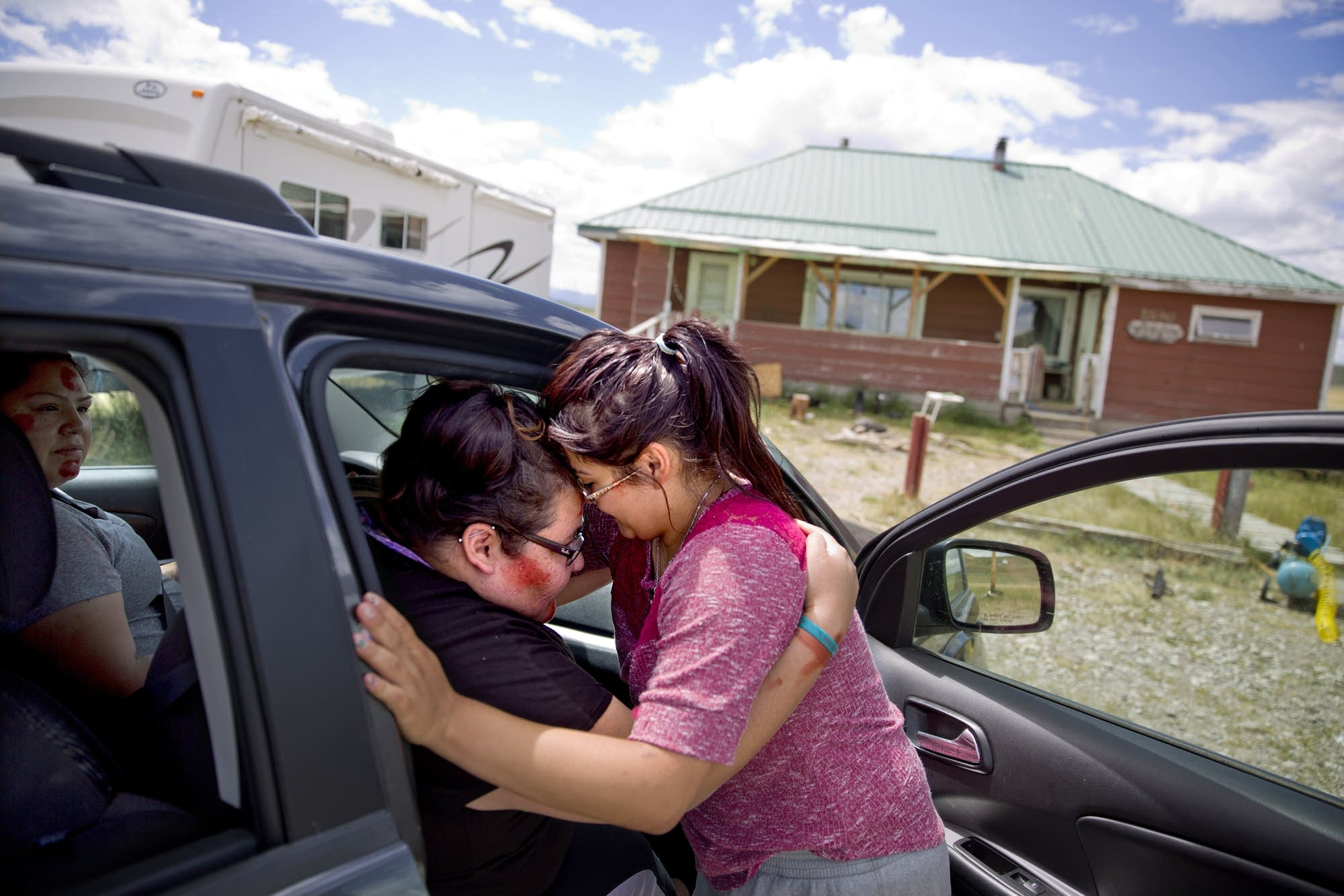 Kimberly Loring, left, touches her forehead to her little sister, Jonnilyn.