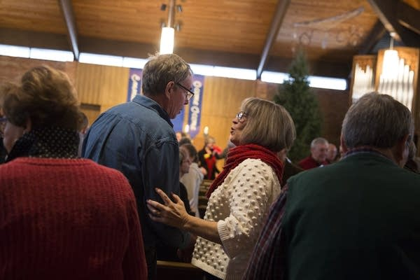 Parishioners greet each other at the beginning of service