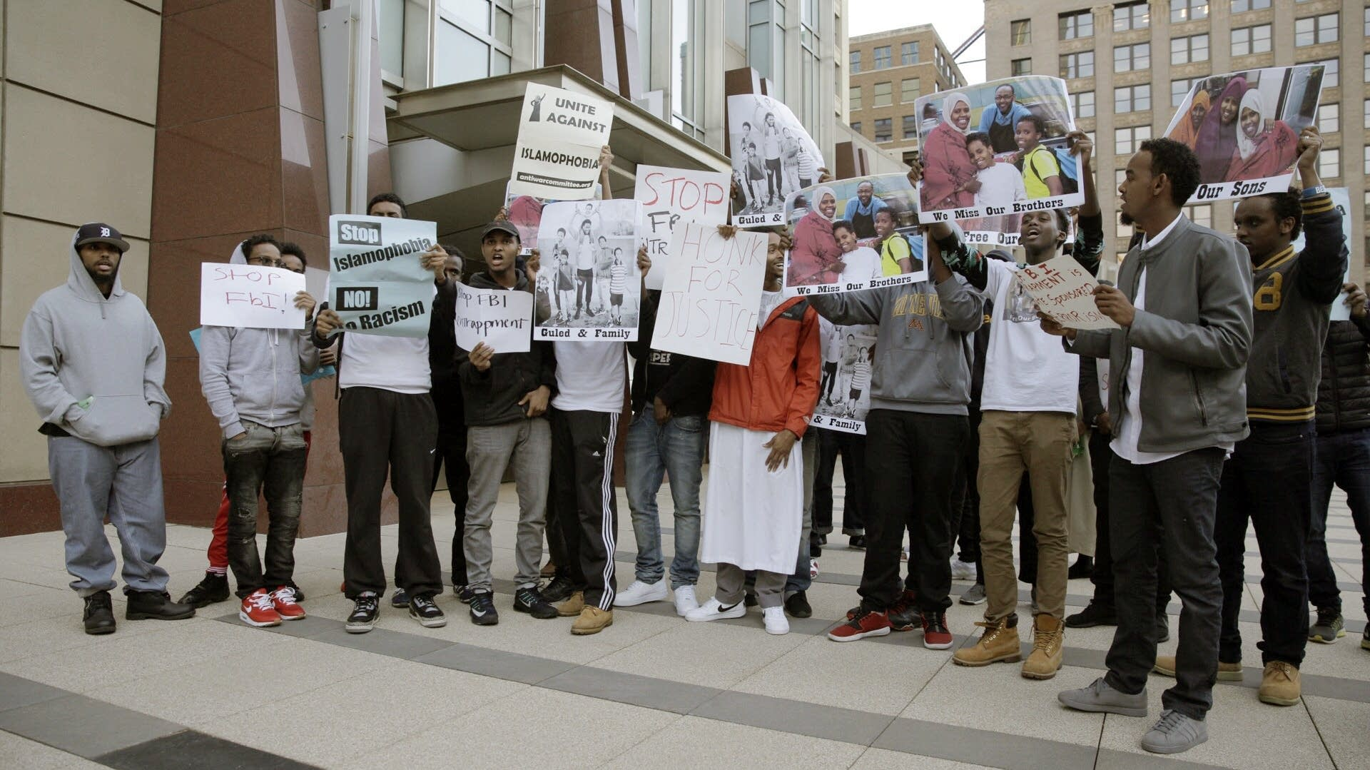 Young men show their support for those who were sentenced.