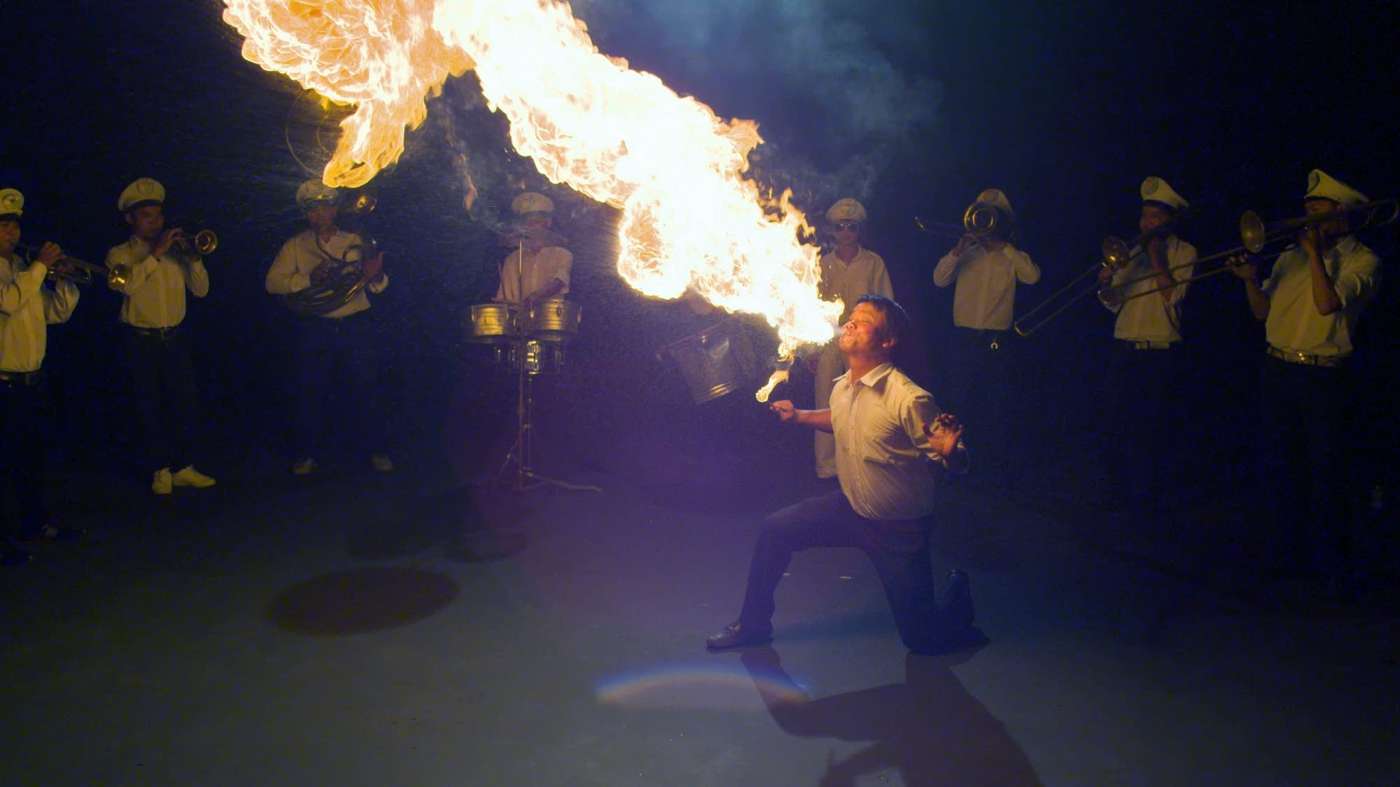South Vietnamese funerals often include street performers like fire eaters.